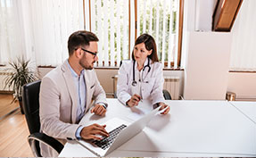 Man discussing results with a doctor