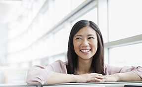 Woman smiling at an office