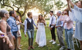 Bride and groom and their guests celebrating their wedding in the backyard